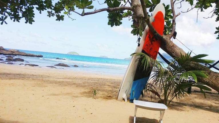 Surfing in Nacpan Beach, El Nido, Palawan